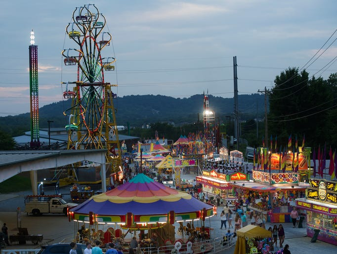 The midway comes to life on opening night of the Williamson County Fair Friday, August 1, 2014 at the Williamson County Ag Expo Park in Franklin, Tenn.
