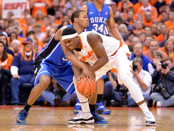 Syracuse forward C.J. Fair is defended by Duke forward Rodney Hood during the first half of a game Feb. 1 at the at Carrier Dome.
