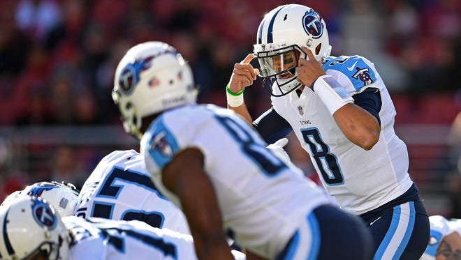 Titans quarterback Marcus Mariota (8) calls a play at the line of scrimmage during the first quarter Sunday.