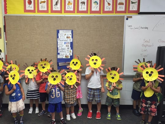 Preschool students in the Bayberry Elementary School Extended School Year program show off their craft projects. The program instructor is Leanne Salerno, who is also a Watchung resident.""