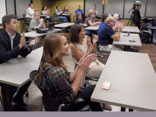 Supporters clap as Indiana House district 77 candidates Johnny Kincaid and Ryan Hatfield are introduced during a debate at the Evansville Courier & Press Wednesday.
