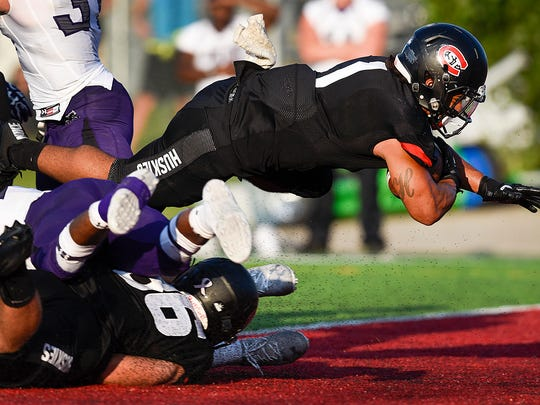 St. Cloud State runningback Jaden Huff dives into the