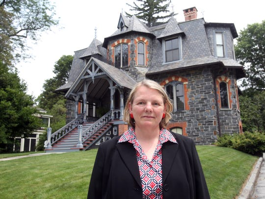 Holly Wahlberg stands in front of her historic home