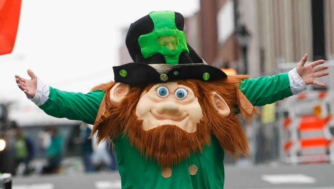 A leprechaun walks along the parade route at last year's St. Patrick's Day parade in Wilmington.