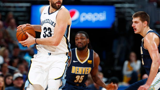 Memphis Grizzlies center Marc Gasol, front left, of Spain, pulls in a loose ball as Denver Nuggets center Nikola Jokic, front right, of Serbia, and forward Kenneth Faried defend during the second half of an NBA basketball game Friday, Nov. 24, 2017, in Denver. The Nuggets won 104-92. (AP Photo/David Zalubowski)
