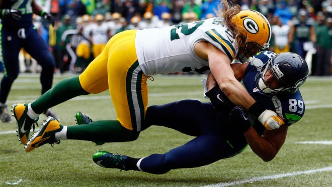 Seattle Seahawks receiver Doug Baldwin is tackled by Green Bay Packers linebacker Clay Matthews after making a catch during the third quarter of Sunday's NFC championship game at CenturyLink Field in Seattle.