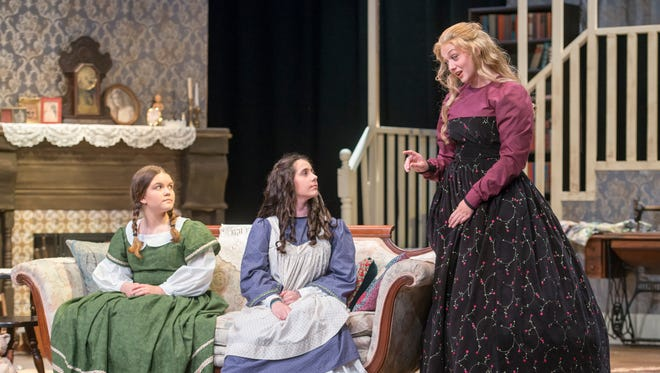 Elyse Rose (Beth), from left, Rina Champlin (Amy), and Alex Iverson (Meg) perform during a dress rehearsal of Little Women at the Pensacola Little Theatre in Pensacola on Tuesday, April 3, 2018.