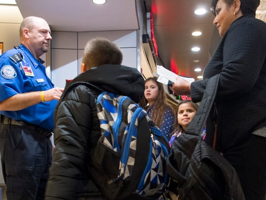 A Transportation Security Administration official directs