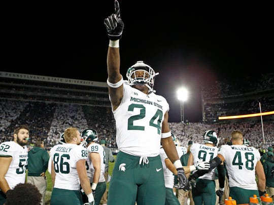 Michigan State's Elijah Collins celebrates the go-ahead touchdown at Penn State last season.