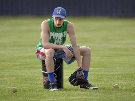Kimball senior baseball player Joey VonWahlde, right,