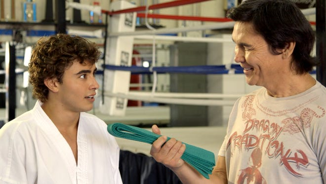"Jansen Panettiere, left, appears in ""The Martial Arts Kid"" with real-life martial arts star Don ""The Dragon"" Wilson."