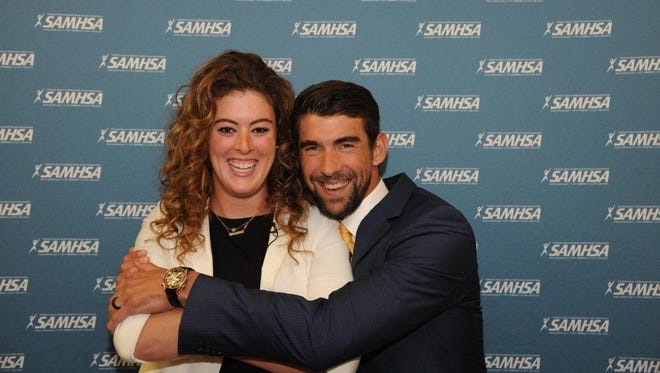 Olympic champions Allison Schmitt and Michael Phelps spoke at National Children's Mental Health Awareness Day, which was hosted by the Substance Abuse and Mental Health Services Administration (SAMHSA) at George Washington University on May 4.