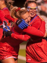 CAL's Madeline Coombe, left, and Abigail Lala, right, celebrate their victory over Assumption in the state field hockey championship.20 October 2017