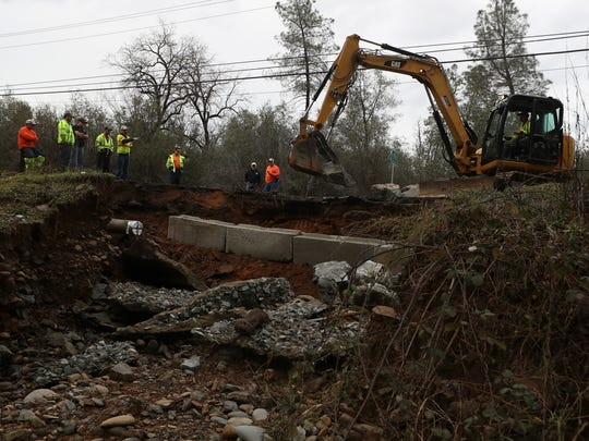 Redding Public Works employees begin the repair Monday