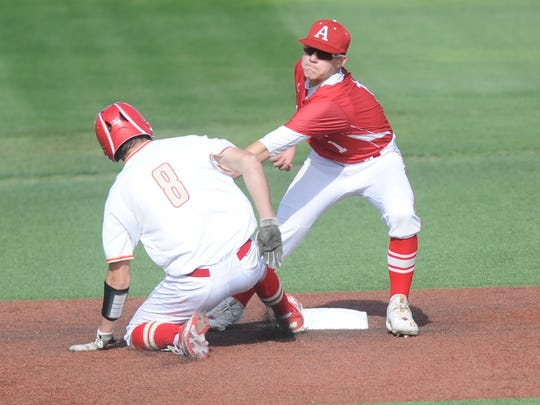 Albany shortstop Josh Dyer, right. tags out West Texas' Trey Griffin on a pickoff by pitcher Brian Hamilton for the final out in the third inning. The Lions beat WT 7-5 in the first game of a Region I-2A series in 2017 in Lubbock.