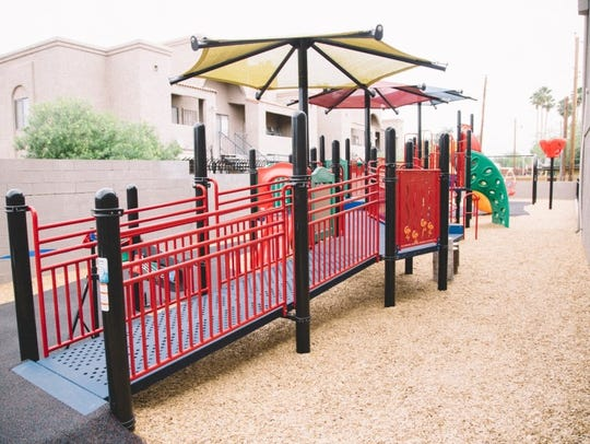 The adaptive playground is shown before the fire.