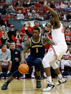 Michigan's Charles Matthews drives baseline against Ohio State's Andre Wesson in the first half Monday, Dec. 4, 2017 in Columbus, Ohio.