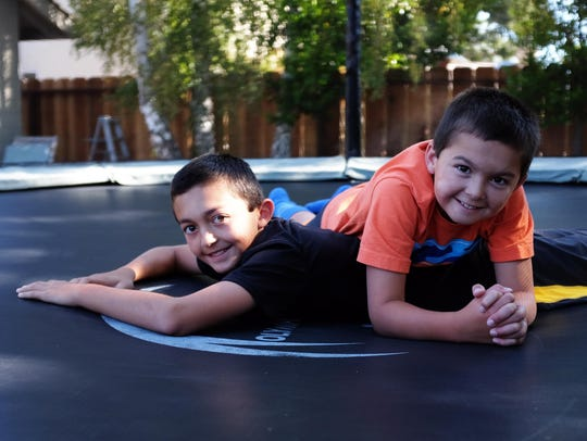 Ethan, 12, left, and Evan Silacci, 9, take a break
