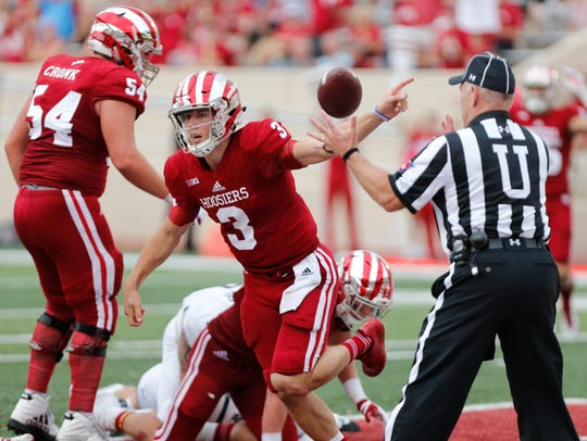 Indiana's Tyler Green (3) scores a touchdown after