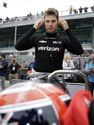IndyCar driver Will Power (12) gets ready to climb into his car during practice on fast Friday, May 20, 2016 afternoon for the 100th running of the Indianapolis 500 at the Indianapolis Motor Speedway.