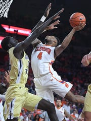 Clemson guard Shelton Mitchell (4) is found by Georgia Tech forward Abdoulaye Gueye (34) while scoring during the 2nd half on Wednesday, February 1,  2017 at Clemson's Littlejohn Coliseum.