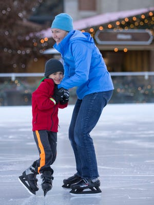 Wendy Noble, Carmel, with son J.T., try out ice J.T.'s first ice skating session at Carmel's Christkindlmarkt, Carmel, Wednesday, Nov. 29, 2017.