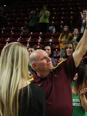 John Spini acknowledges the fans after his final meet as Arizona State women's gymnastics coach.