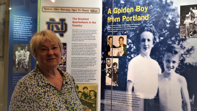 Nathalie Andrews, executive director for the Portland Museum, stands by the Paul Hornung exhibit.