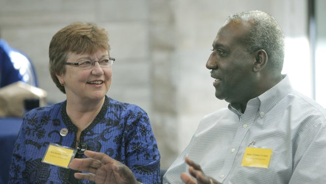File photo: Kate Bennett and James Norman talk during the Facing Race, Embracing Equity summit  at the Asbury First United Methodist Church last year.