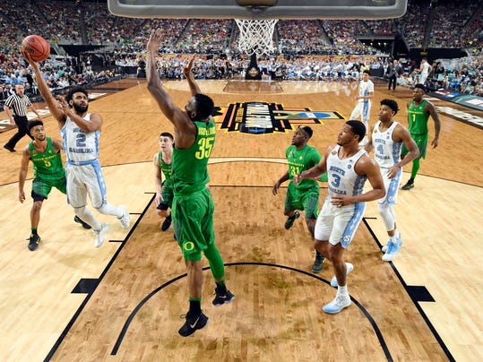 North Carolina's Joel Berry II (2) takes a shot against Oregon's Kavell Bigby-Williams (35) during the second half in the semifinals of the Final Four NCAA college basketball tournament, Saturday, April 1, 2017, in Glendale, Ariz. (AP Photo/Chris Steppig, Pool)