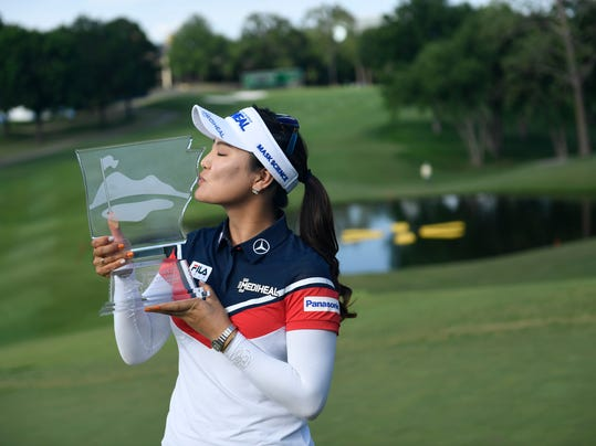 So Yeon Ryu, from South Korea, kisses her trophy for photographers after winning the LPGA Wal-Mart NW Arkansas Championship golf tournament at Pinnacle Country Club in Rogers, Ark., Sunday, June 25, 2017. (AP Photo/Michael Woods)