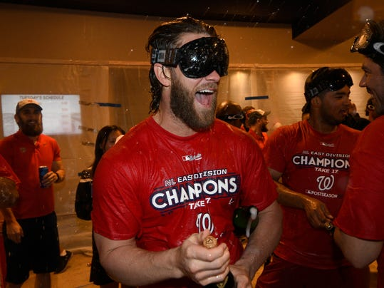 Washington Nationals' Bryce Harper reacts in the locker room as the team celebrates after they clinched the National League East title after a baseball game against the Philadelphia Phillies, Sunday, Sept. 10, 2017, in Washington.(AP Photo/Nick Wass)