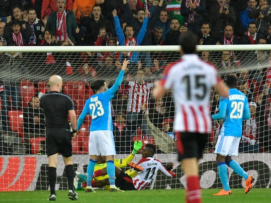 Bilbao's Inaki Williams, center, lies on the pitch as he scores his side opening goal during their Europa League round of 16, 2nd leg, match between Athletic Bilbao and Olympique Marseille, at San Mames stadium, in Bilbao, northern Spain, Thursday, March 15, 2018. (AP Photo/Alvaro Barrientos)