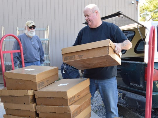 Ray Perry unloads donated venison at the Millsboro Christian Storehouse.