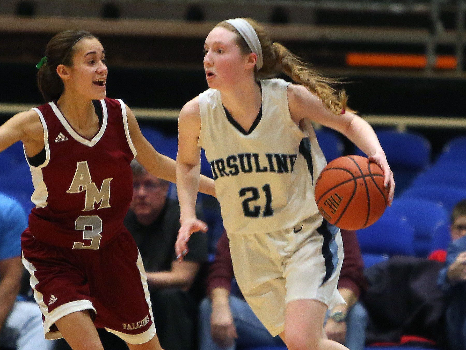 Albertus Magnus guard Dani LaRochelle (3) defends Ursuline forward Katie McLoughlin (21) during a Section 1 Class A semifinal at the Westchester County Center.