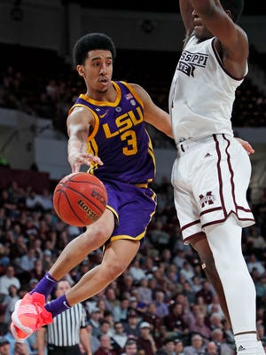 LSU guard Tremont Waters (3) passes past Mississippi State forward Reggie Perry (1) during the second half of an NCAA college basketball game in Starkville, Miss., Wednesday, Feb. 6, 2019. LSU won in overtime, 92-88. (AP Photo/Rogelio V. Solis)