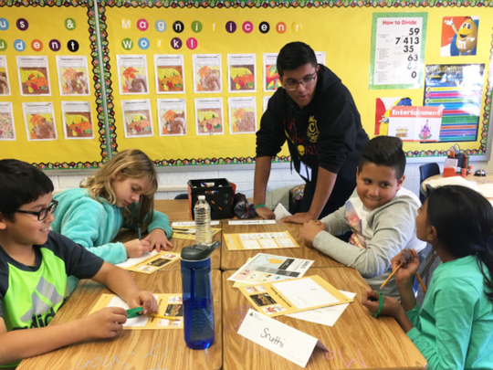 As part of the Junior Achievement High School Heroes program, Piscataway High School Senior Shreyas Bhise works with fourth grade students at Martin Luther King Intermediate School in Piscataway. The students study entrepreneurship and how to combine positive traits of entrepreneurs with a geographical area that offers the right climate, industry and transportation options to build a successful business.