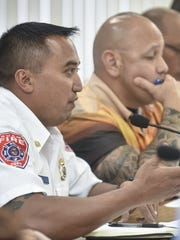 """Fire Chief Joey San Nicolas speaks at the Guam Legislature on Feb. 10 during a Terrorist Response Roundtable, aimed at evaluating challenges posed by the recent rash on bomb threats on the island. """"We don't have endless resources and we could always use more, but we are capable of responding as needed,"""" said San Nicolas."""