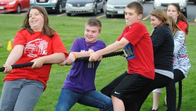 Students from left: Jasmine Adkins, Jeb Loomans, Jacob Young, Sadie Newbury, Samantha Morgen and Paige Winter play tug-of-war during Brandon School Family Fun Night.