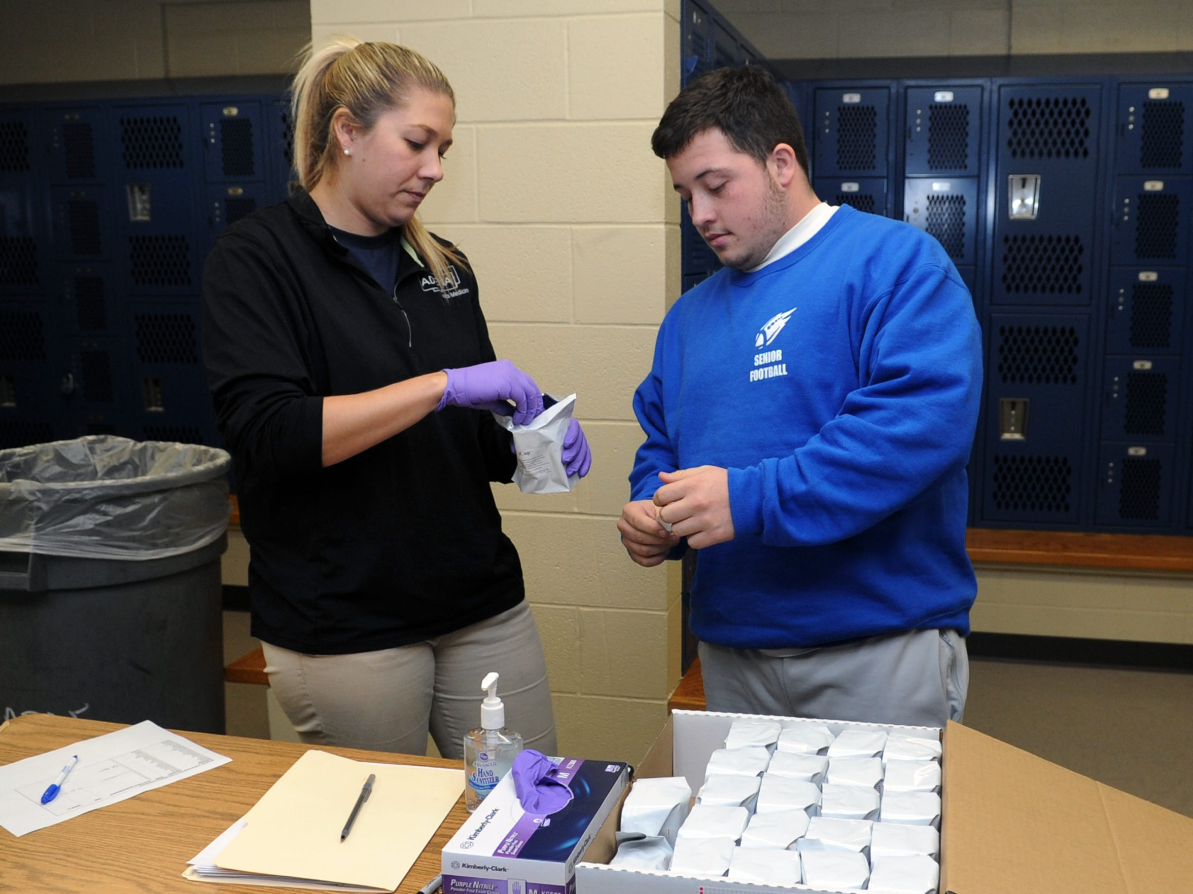 Leo Woods prepares to take a drug test with assistance from Andrew Gobel, athletic trainer, Wednesday, Dec. 16, 2015, at Chillicothe High School as part of the Keys to Success program.