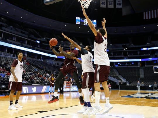 Iona guard A.J. English passes under the basket Wednesday,