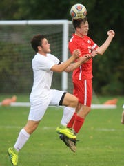 Canton senior Matt Rockafellow (right) tries to deflect the ball away from Plymouth senior Anthony Iacopelli during Tuesday's district game.
