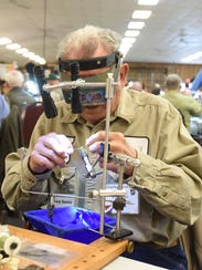 Tony Spezio of Flippin crafts a lure during the first day of the 2017 Sowbug Roundup.
