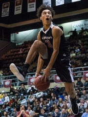 Saint Andrew's Brycen Goodine (0) takes a shot net during the Slam Dunk Contest at the Wicomico Youth and Civic Center on Friday, Dec. 29, 2017.
