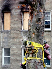 A make-shift shrine is placed on a tree outside the apartment building of Thomasine Evans and Michael Wright, the formerly homeless couple who died in a fatal shooting and arson in their apartment on Nov. 18 2005.