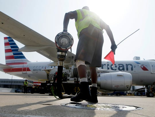 Scott Mills finishes fueling up an American Airlines