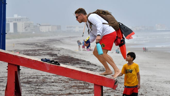 Lifeguards return after lightning was in the area. Wednesday rain kept all but a few people from enjoying the Cocoa Beach.
