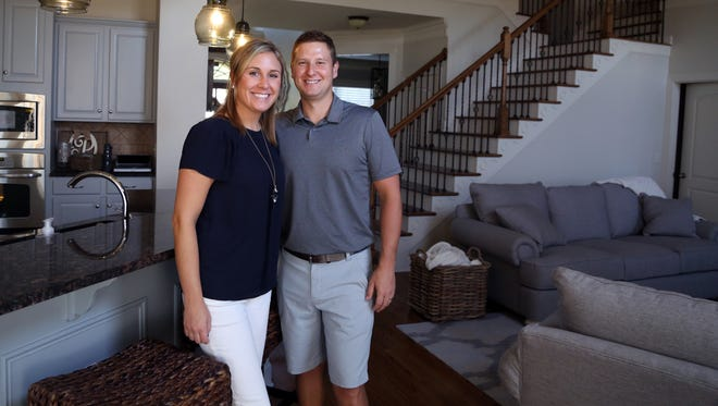 Rachel and Nick Porco stand inside their home in Brentwood. The original buyer of their former home in the Lenox Village area of South Nashville backed out, leaving the sale in doubt until a backup buyer stepped in.