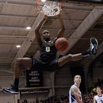 Purdue guard Jon Octeus (0) dunks in the second half of a 68-60 victory at Northwestern.