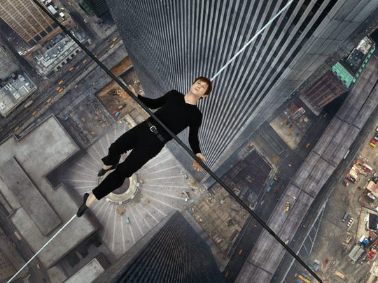 "Joseph Gordon-Levitt in a scene from, ""The Walk."" The film is about high-wire artist Phillippe Petit's cabled walk between the Twin Towers in 1974."